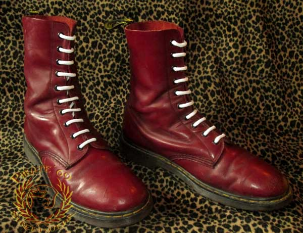 For sale is a used pair of vintage Dr. Martens boots, made in England. Made of leather uppers printed with a black and red colorway (the interior of the shafts are tan leather, so the coloring on th.